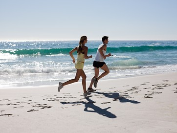 Young couple jogging on beach